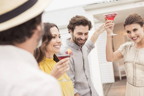 Couple and friends socializing on a cocktail party - SDAHF00588