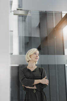 Portrait of blond businesswoman looking at distance - BMOF00170