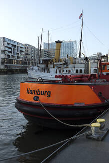 Museum ships at Hafencity with Elbe Philharmonic Hall in the background, Hamburg, Germany - GISF00538