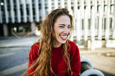 Portrait of happy young woman in the city - KIJF02918