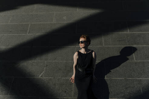 Red-haired woman with sunglasses, enjoying sunlight - OGF00143