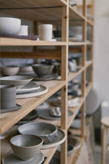 Assortment of products on shelf in a pottery - JPIF00314
