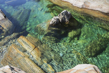 Stones and rocks in clear turquoise waters of Verzasca river, Verzasca Valley, Ticino, Switzerland - GWF06453