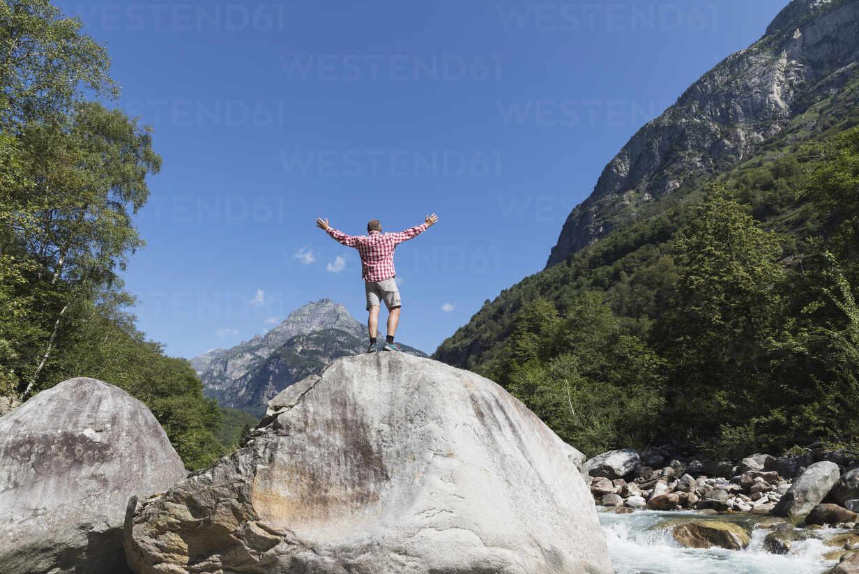 Man standing on rock at Verzasca river, Verzasca Valley, Ticino, Switzerland - GWF06459 - Gaby Wojciech/Westend61