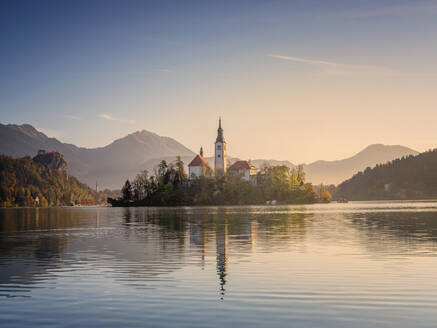 Slovenia, Bled, Lake Bled at dawn with Assumption Of Mary Churchin background - HAMF00596