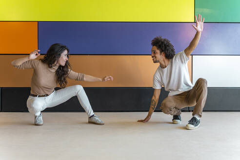 Dancers practicing in front of colorful wall - DLTSF00550