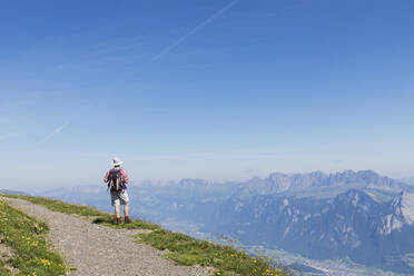 Switzerland, St Gallen Canton, Glarus Alps, Man hiking the Panoramic hiking trail in the Tectonic Arena Sardona - GWF06477