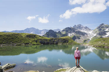 Switzerland, St Gallen Canton, Glarus Alps, Woman looking at Wangs Lake - GWF06483