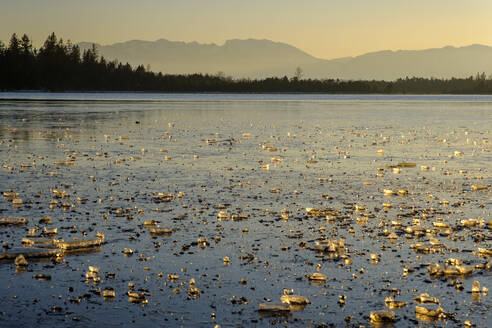 View of frozen Kirchsee at sunset, Bavaria, Germany - LBF02901