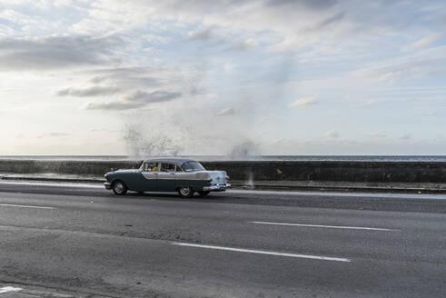 Vintage car on the street at Malecon, Havana, Cuba - PAF01930