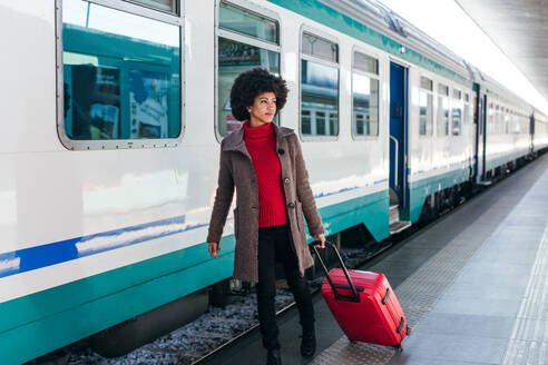 Tourist woman going for vacation trip on train - CAVF75682