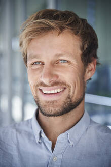 Portrait of happy businessman - PNEF02376