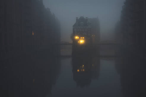 Germany, Hamburg, Wasserschloss shrouded in thick fog - KEBF01507