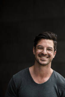 Portrait of smiling casual man - KNSF07678