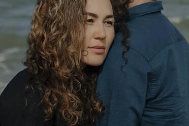 Portrait of woman leaning on her husband's shoulder - OGF00172