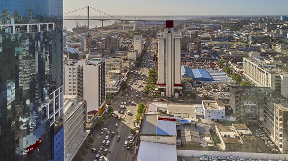 Mozambique, Maputo, Aerial view of Baixa de Maputo downtown with Maputo-Katembe Bridge in background - VEGF01639