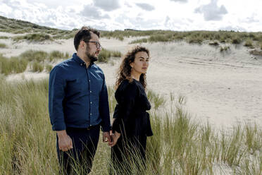 Couple walking in the dunes, The Hague, Netherlands - OGF00188