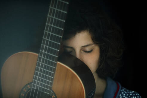 Portrait of young woman with guitar - OGF00201