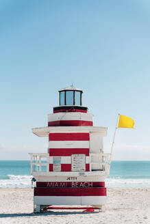 Red-white striped attendant's tower with  yellow flag, Florida, USA - GEMF03477