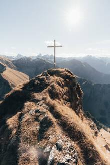 Summit with cross in German Alps against blue sky - CAVF76200