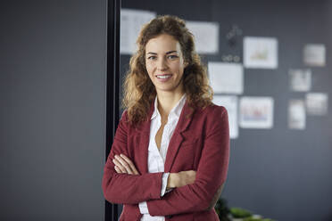 Portait of smiling businesswoman in office - RBF07071