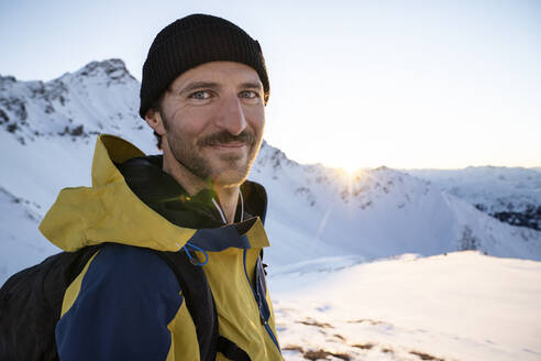 Portrait of man during ski tour, Lenzerheide, Grisons, Switzerland - HBIF00080