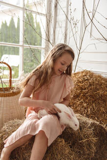 Children at Easter with rabbits and ducks - CAVF76533