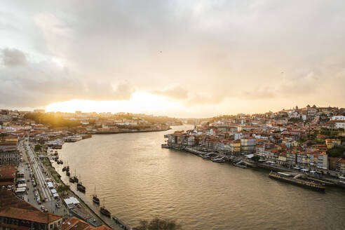 Portugal, Porto, Sky over riverside city at sunset - LJF01389