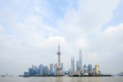 The Shanghai city skyline with the Oriental Pearl TV Tower, the Shanghai Tower and the Shanghai World Financial Center, Pudong, Shanghai, China, Asia - RHPLF14012