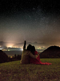 Rear View Of Couple With Flashlight Against Constellation - EYF00634