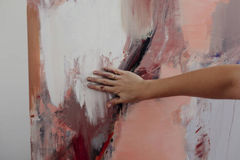Hand of a female painter on her painting - OGF00224