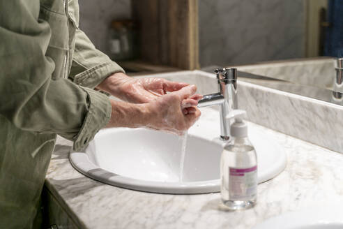 Man washing hands with sanitizer - AFVF05763