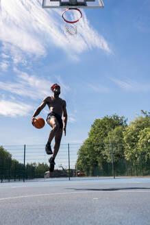 Man playing basketball, dunking - JPIF00504