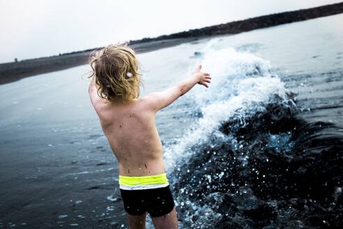 Boy playing at the seafront, Adeje, Tenerife, Canarian Islands, Spain - IHF00279