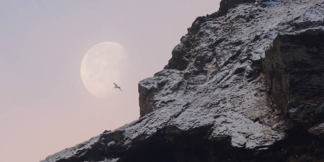 Moon setting behind snow covered mountains, Iceland, Polar Regions - RHPLF14289