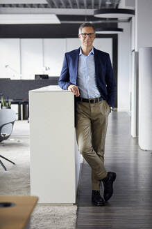 Portrait of confident businessman in office - RBF07161