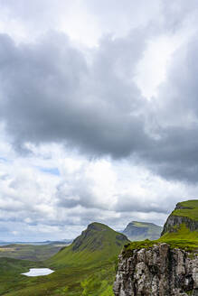 Lake, Cliff, Sky with Clouds in Quiraing Isle of Skye Scotland - CAVF77260
