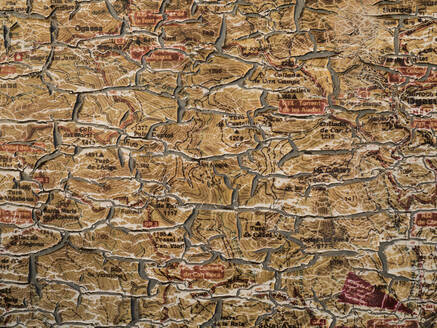 Spain, Old weathered map peeling off wall - JMF00483