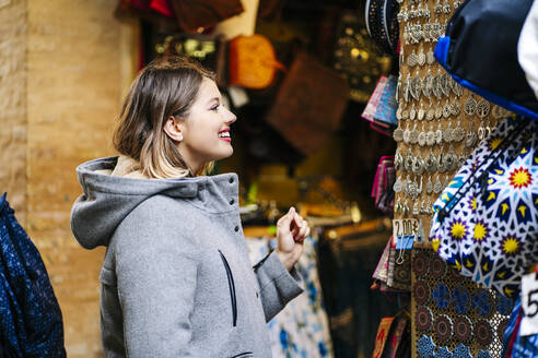 Happy young woman shopping in the city - DGOF00575