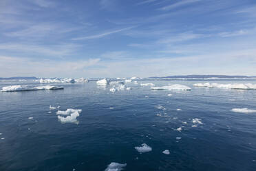 Melting polar ice on sunny blue Atlantic Ocean Greenland - HOXF05783