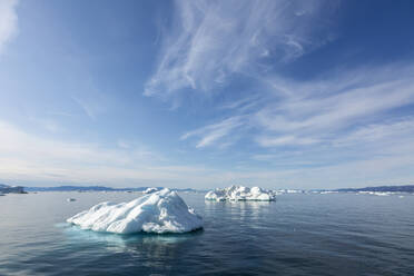 Melting polar ice on sunny blue Atlantic Ocean Greenland - HOXF05792