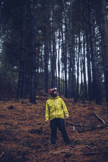 Man standing in forest, Spain - RSGF00246