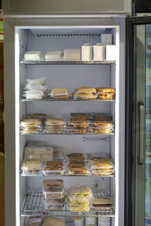 Sealed food in fridge in a small food store - AFVF05878