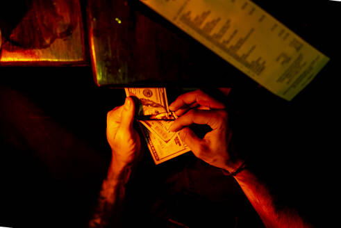 Man paying bill , counting dollar notes, New York City, USA - OCMF01126