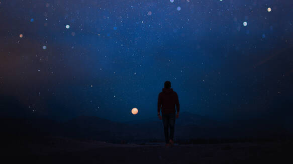 Rear View Of Man Walking Against Sky At Night - EYF01861