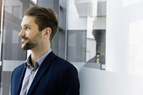 Portrait of bearded young businessman looking at distance - BMOF00343