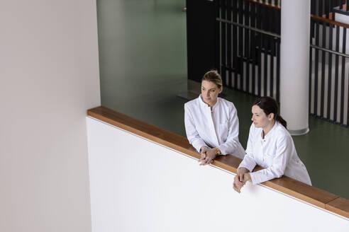 Two female doctors having a break in hospital - BMOF00362