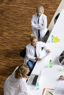Female doctor in a meeting in conference room - BMOF00364