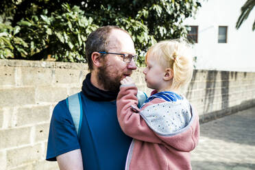 Portrait of happy father carrying his little daughter - IHF00316