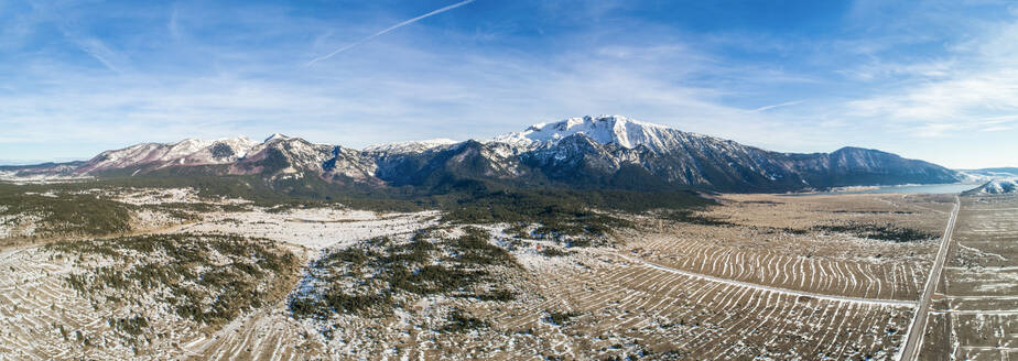 Panoramic aerial view of winter landscape of famous Blidinje nature park in Bosnia and Herzegovina with Cvrsnica mountain dominating the scene. - AAEF07195